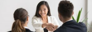 A woman shaking hands with a client