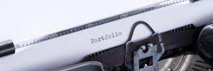 An old typewriter showing the word: Portfolio